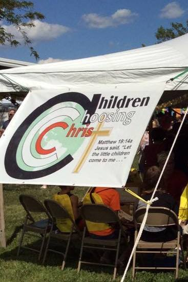 children choosing christ tent
