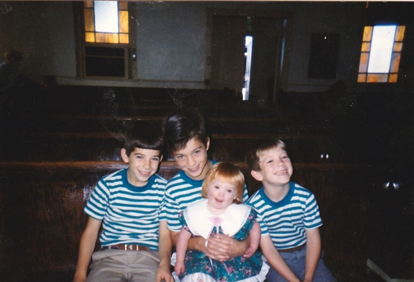 The three oldest Gerencser children with their Down Syndrome sister, 1990