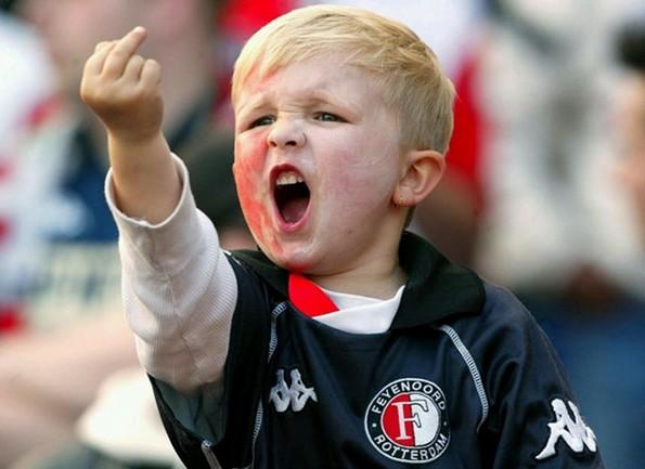boy giving middle finger